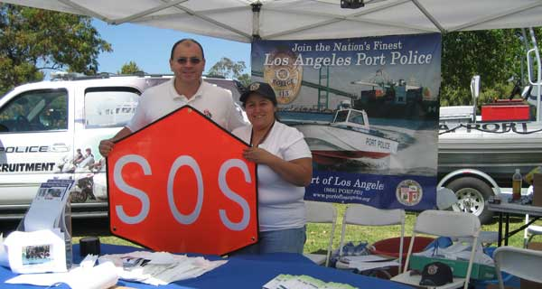 SOS Flag and Nina Gonzalez Los Angeles Port Police Officer